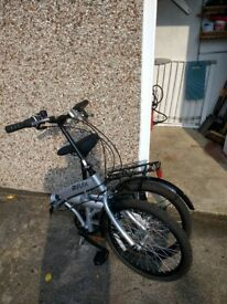 "Reflex Tempus 20"" silver foldable bike. Never been ridden. Adjustable seat, mud guards, stand, 6gear"