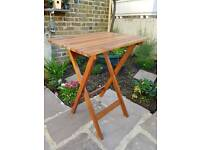 Wooden, foldable table, in/-outdoors