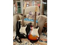 Two electric guitars with amplifiers