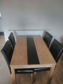 Ash veneer dining table with 4 black chairs