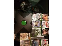X Box console bundle (like new. hardly used). 2 controllers. 9 games. Manual. Cable