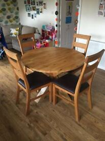 Round oak dining table and 4 chairs