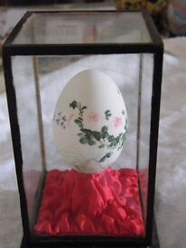 Chinese painted egg in case
