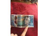 Early mint plastic £5 note AA122483