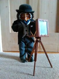 collectable standing owl dressed as a photographer with an old fashion wooden camera