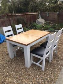Oak table and chairs, seat covers will be changed to your choice