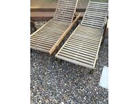 2 wooden loungers with brand new cushions and small table