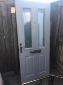 Double glazed metal composite door