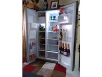 American fridge freezer in excellent condition with ice and ice water dispenser.