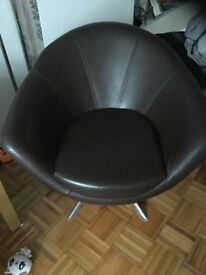 Brown Leather swivel armchair