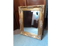 Small carved ornate gold mirror