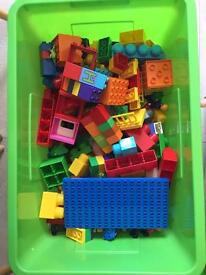 Large box of Duplo and mega blocks pieces