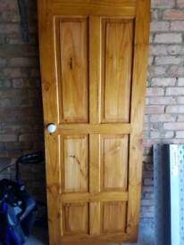 Wood door with handle hinges