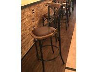 Restaurant tables chairs and bar stools