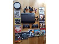 PS3 Slim 12GB console + 2 controllers + 10 games