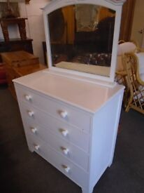 Chest of drawers and mirror