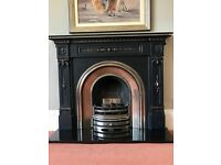 Victorian reproduction fireplace horseshoe design, black and highlighted including hearth and fire