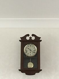 Wall clock with 7 day movement