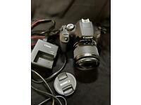 Canon EOS 2000D DSLR camera.