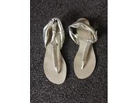 Size five gold flip flops