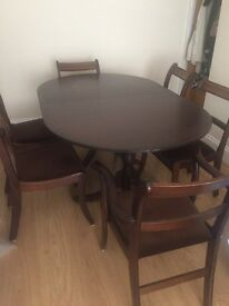 Dining table (extending) and 6 chairs including 2 Carvers