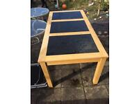 Solid wood table with glass panels