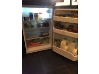 Immaculate condition under counter hotpoint fridge and freezer in black...less than 2 years old!