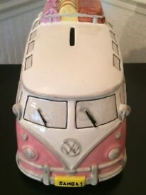 2 x Campervan Money boxes. One is blue and one is pink.