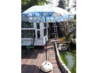 Parasol with water fill base good condition