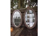 Reclaimed 2 oval shaped 1930 windows