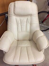 Cream coloured leather swivel armchair. Mahogany feet.
