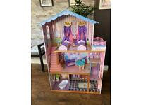Wooden Dolls House with free accessories.