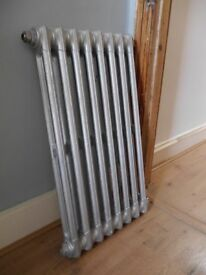 Good condition, 2 column, 8 section traditional cast iron radiator. Hand burnished finish (silver)