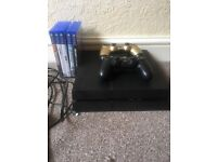 PS4 500mb, Gold controller, Fifa 17,Battlefield 1,Star Wars Battlefront,COD Black OpsIII and Fifa 16