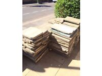 20 sq m of concrete paving slabs