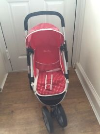 Toy red buggy pushchair