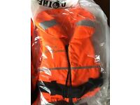 New and unused Reefwear childrens 100N life vest x 2 size large child. See photo for size chart