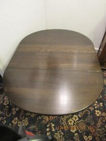 Quality dark oak drop leaf dining table in very good condition