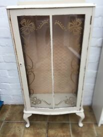 Shabby chic wooden cabinet with glass front
