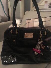 Floozie patent black handbag