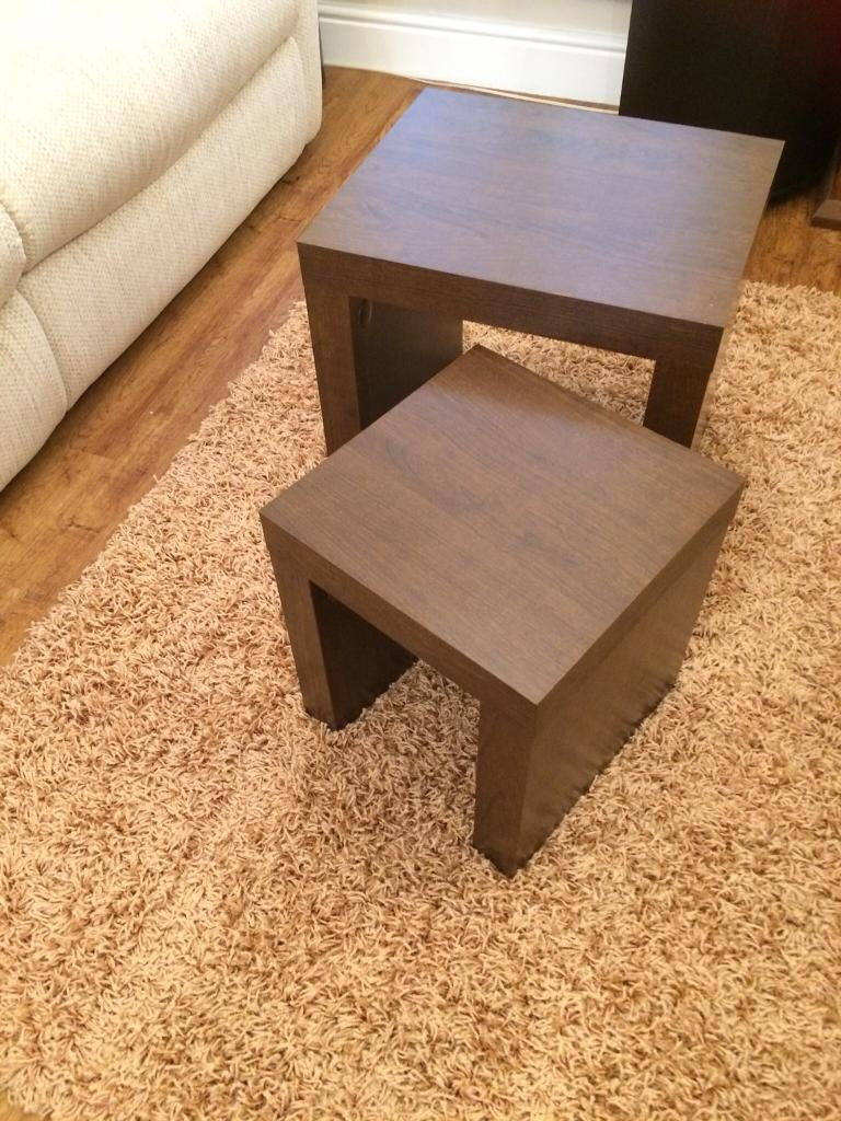 Nest of dark wood tables for sale.