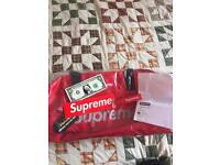 Red supreme duffle bag