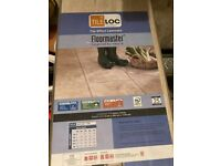 Laminate Tile Effect Flooring one whole pack and a few in another box plus door bar