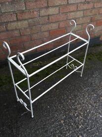 Metal decorative shoe rack painted cream colour.