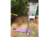 Purple Maxi Micro scooter with wheel whizzers and scoobit
