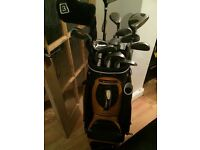 Sun mountain bag with 15 assorted clubs n 4 balls