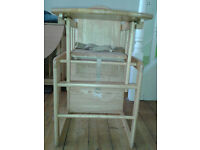 Wooden highchair that can be converted into small table and chair