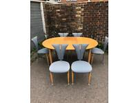 Stunning quirky retro table and six chairs.