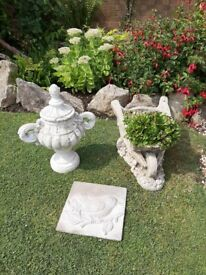 Bundle of three garden ornaments (urn, plaque, and wheelbarrow plant pot)