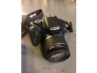 Canon EOS Rebel T2i Camera with lens, strap, memory, and recharger